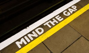 Mind the Gap sign on the edge of a London Underground Tube station's platform