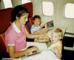 My mom, brother, and I reading on the plane