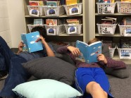 Members of the community sharing a great book!