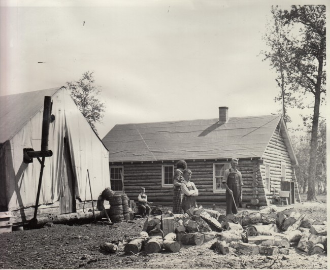 World Wide Photo 7/25/1936; Taken by Father Hubbard, the Glacier Priest. Photo shows one of the first families to get a new home. Others were not so lucky and were still in tents when the first snow fell.