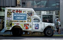"""The Movement Library, supported by Moe's, Shakespeare and others.  """"Radical Literature Loaned Here"""""""