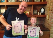 My son, Evan, and I showing off our hiccupotamuses after Aaron Zenz's author visit